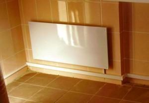 Панель отопления на плиточной стене